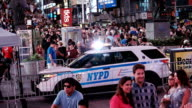 New York City Police Department patrols Times Square New York City at night time during the summer season Midtown Manhattan Times Square Broadway and...