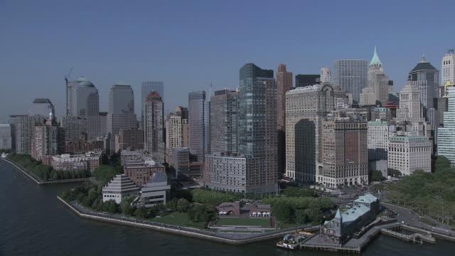 AERIAL New York City skyline along the banks of the Hudson River / New York, United States