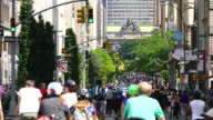 New York City Summer Streets were opened for people to play, run, walk and bike on Aug. 19 2017. Many bikers and people run along the Park Ave. Midtown Manhattan during the Summer Streets are opened. City traffic crosses among the crowd of Summer Streets.