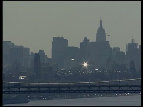 Waterways and skylines USA New York New York City EXT View of Manhattan skyline across Hudson River including bridge / Hazy Manhattan skyline and...