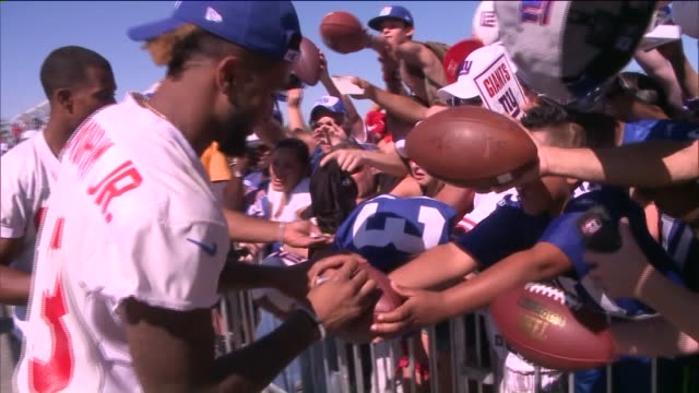 New York Giants Players Sign Autographs at a PreSeason Event