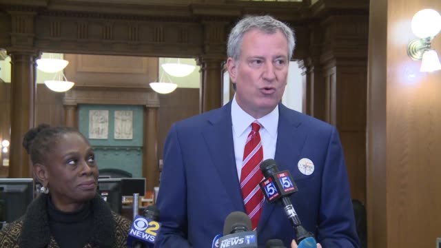 New York mayor Bill de Blasio speaks to reporters at a polling station in New York