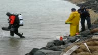 New York police divers scoured the gray waters near a popular beach as the search widened in a suspected serial killer case feared to have claimed up...