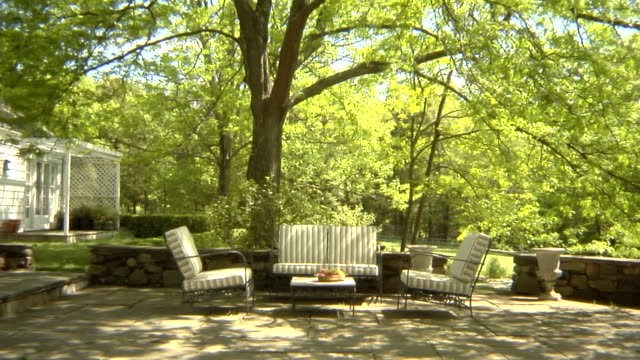 MS, USA, New York State, Bedford Hills, outdoor seating area in back garden