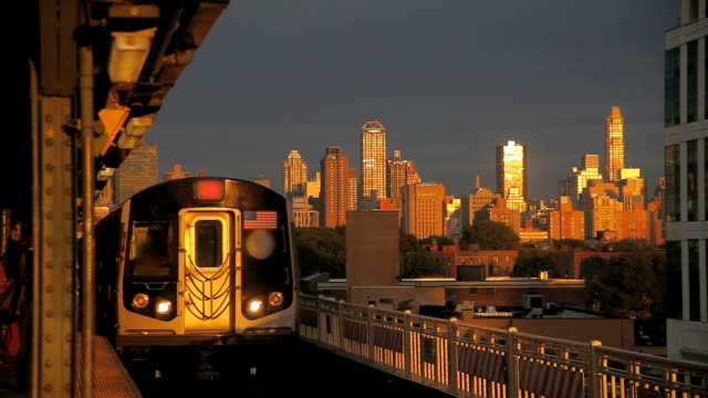 New York Subway Train Leaving Manhattan and Arriving at Station in the Morning