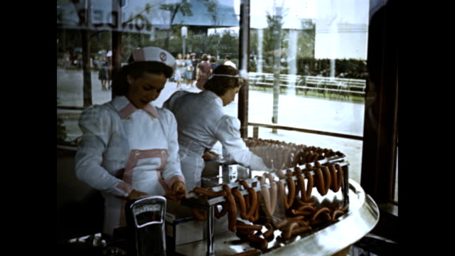 New York World's Fair Swift's Premium Bacon industrial food demonstration stand VS two women in uniform standing in window wrapping sausages assembly...
