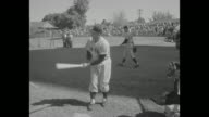 New York Yankees at spring training in St Petersburg Florida players hitting and fielding balls / players running onto field / Casey Stengel manager...