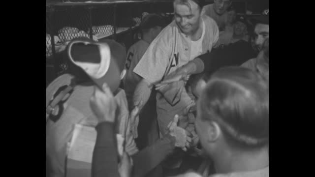 New York Yankees players enter dressing room at Sportsman's Park stadium in St Louis after defeating the St Louis Cardinals to win the World Series /...