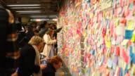 New Yorkers are covering the subway station wall in emotional election sticky notes after the election at Union Square Station in 2016