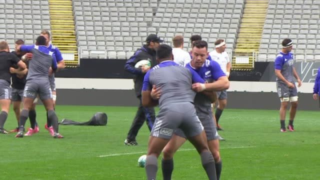 New Zealand All Blacks rugby players grappling exercise during training at Eden Park in Auckland in 2016