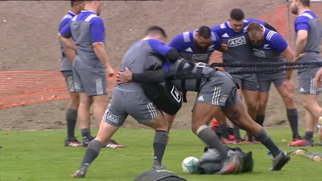 New Zealand All Blacks rugby players tackle training with resistance cords in Dunedin in 2016