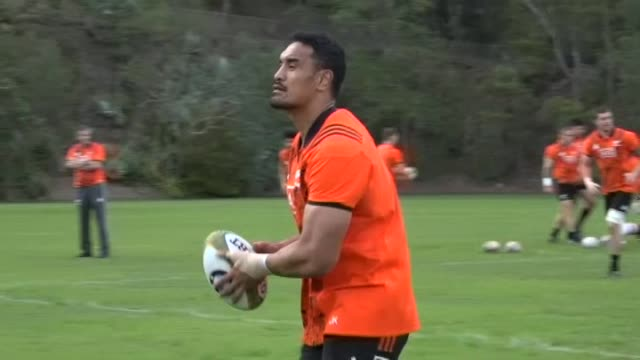 New Zealand All Blacks rugby squad running passing drill at training in Brisbane in 2017