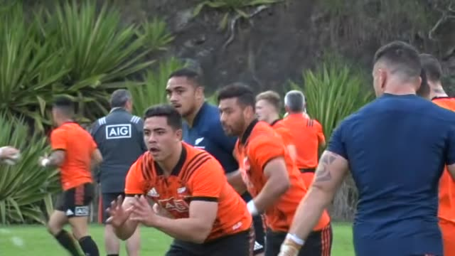 New Zealand All Blacks rugby team drill catching ball kicked by assistant coach Wayne Smith during training in Brisbane in 2017