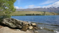New Zealand Lake Dunstan with big rock and moraine