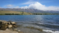 New Zealand Lake Dunstan with moraine and cloud