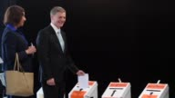 New Zealand Prime Minister Bill English votes in a general election after a late surge in popularity ahead of Saturday's main vote saw him open up a...