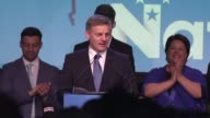 New Zealand's conservative prime minister Bill English reacts after his party delivered an unexpectedly strong performance to claim 46 percent of the...