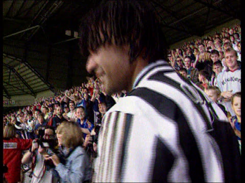 Newcastle United Search for New Manager LIB St James's Park Fans applauding Gullit on his appointment as manager CBV Gullit facing fans as they...