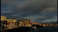 NewcastleuponTyne bridges and buildings / Northern Rock shareholders' meeting Glass panels of The Sage building/ traffic crossing Tyne Bridge...