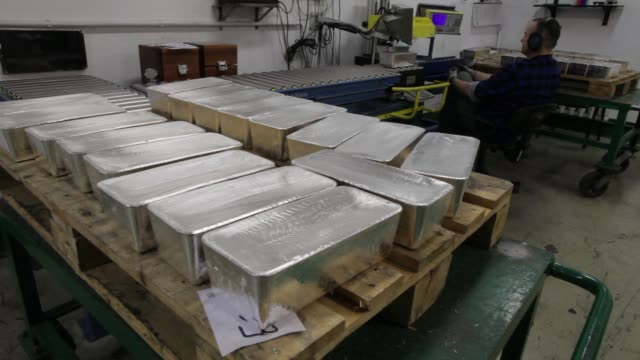 Newly cast silver bullion bars sit ahead of export at the KHGM Polska Miedz SA smelting plant in Glogow Poland on Monday March 23 2015 SHOTS a...