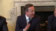Newly elected Conservative Cabinet meets ENGLAND London INT David Cameron MP arriving in room for first Conservative Cabinet meeting of new...