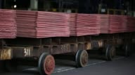 Newly made copper cathode sheets sit on trolleys in the electrolysis shop at the Uralelectromed OJSC Copper Refinery operated by Ural Mining and...