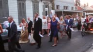 A newly married couple celebrates with a second line parade in the French Quarter on May 9 2015 in New Orleans Louisiana The tenth anniversary of...