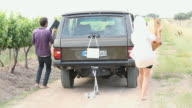 Newlyweds driving away in suv