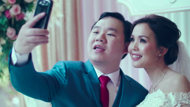 Newlyweds Taking Selfie With Smart Phone Photos