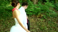 Newlyweds walking in the park