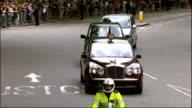 1200 1300 Trafalgar Square Cheering crowds in Trafalgar Square as watching proceedings on large screen Westminster Prince Charles waving from car as...