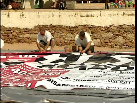 News of the World unveil banner offering reward for Madeleine McCann's return Banner being inflated / people looking on / banner being inflated /...
