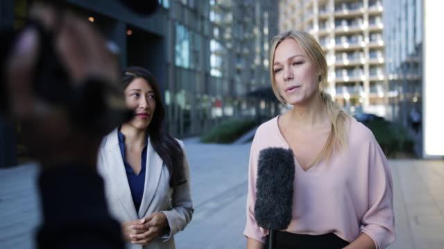 News presenter interviewing on the street