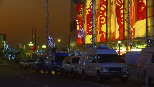 MS, News vans with microwave transmission masts in front of Staples Center, Los Angeles, California, USA,