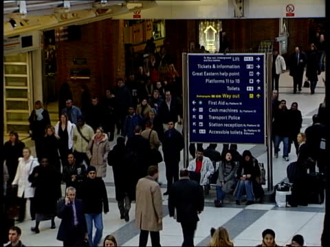 Part one GENERICS RAIL London Liverpool Street Station INT Commuters on railway concourse Rail passengers to and fro on station concourse Passengers...