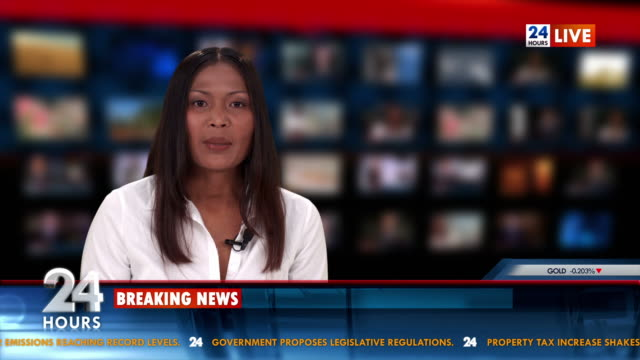 HD: Newscaster Reading The Breaking News