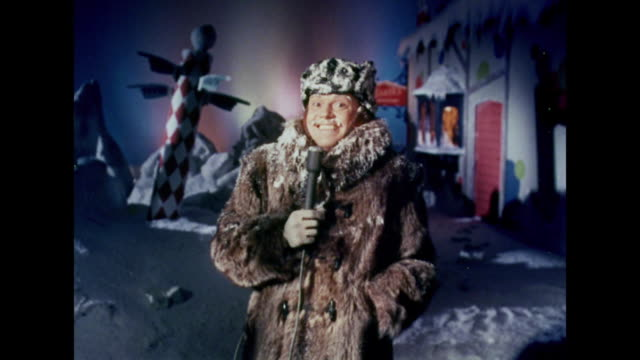 A newscaster reports about Santa Claus from the North Pole