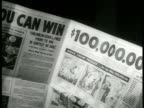Newspaper ad '$100 000 1st Prize' Prize money list MS Boy amp girl trying to solve puzzle CU Puzzle cartoon Racist
