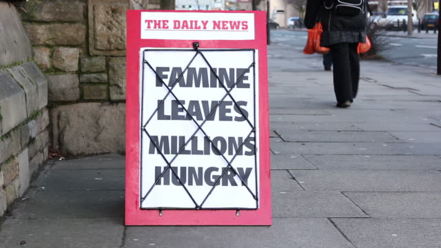 Newspaper Headline Board - Famine leaves millions hungry