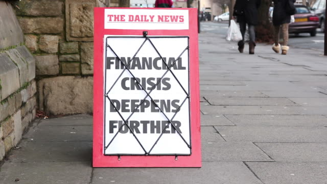 Newspaper Headline board - Financial crisis deepens further