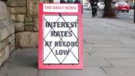 Newspaper headline board - Interest rates at record low