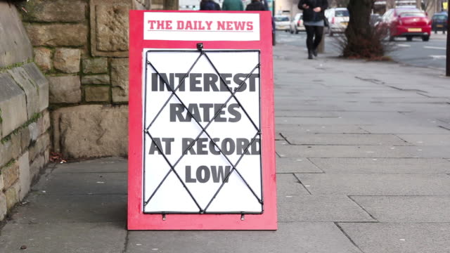 Newspaper headline board - Interest rates at record low