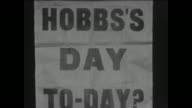 A newspaper placard outside the County Ground in Taunton referring to Surrey batsman Jack Hobbs who would resume his innings on 91 needing another 9...