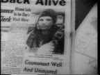 Newspaper with 'Reds Orbit Man' headline and photo of Yuri Gagarin as the first man in space / Yuri Gagarin in uniform walking outdoors / crowd of...