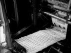 Newspapers come off the printing presses at a newspaper print works