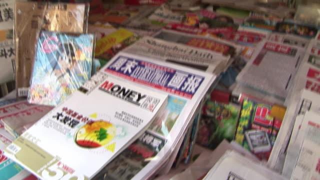 CU, CS, Newspapers in kiosk, Shanghai, China
