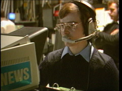 ITV newsreader Gordon Honeycombe memories DATE UNKNOWN London INT Cameraman operating camera in ITN news studion Martyn Lewis sitting at news studio...