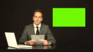 Newsreader or TV reporter reading the news with Green screen