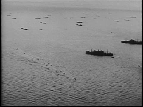 Newsreel / DDay footage / Infantry sets out for the enemy coast on landing ships / Allied Navy boats unload troops and line up for battle /