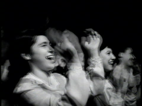 Newsreel /Female fans applauding and cheering wildly at Sinatra concert /